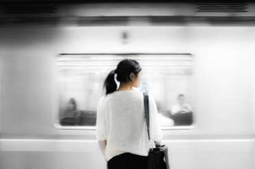 Photo of a woman standing on a subway platform