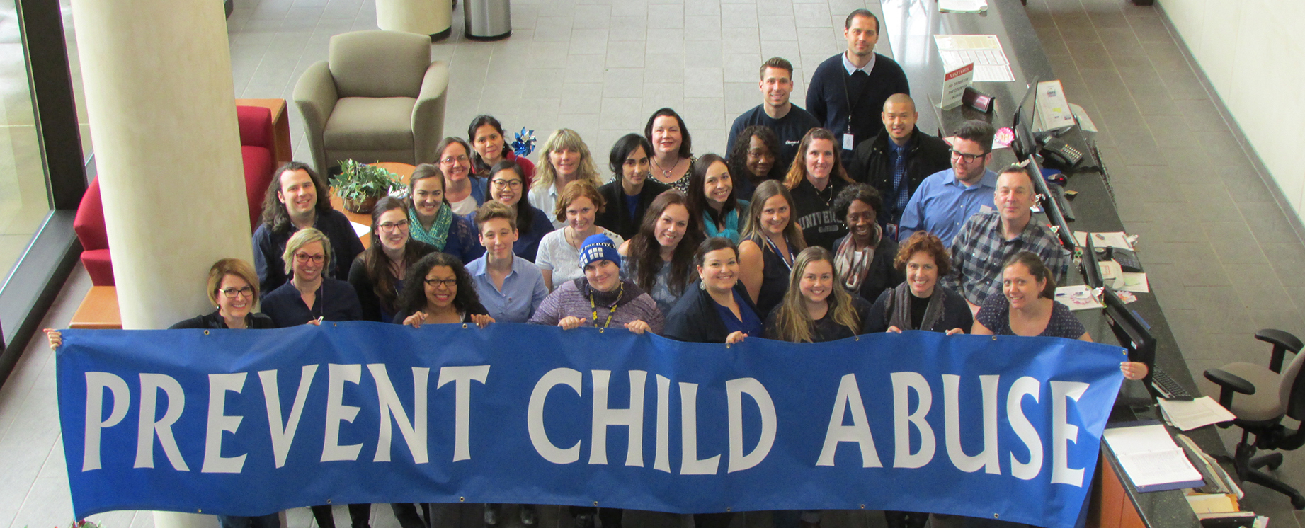 CDSS Employees holding up a Child Abuse Prevention Sign